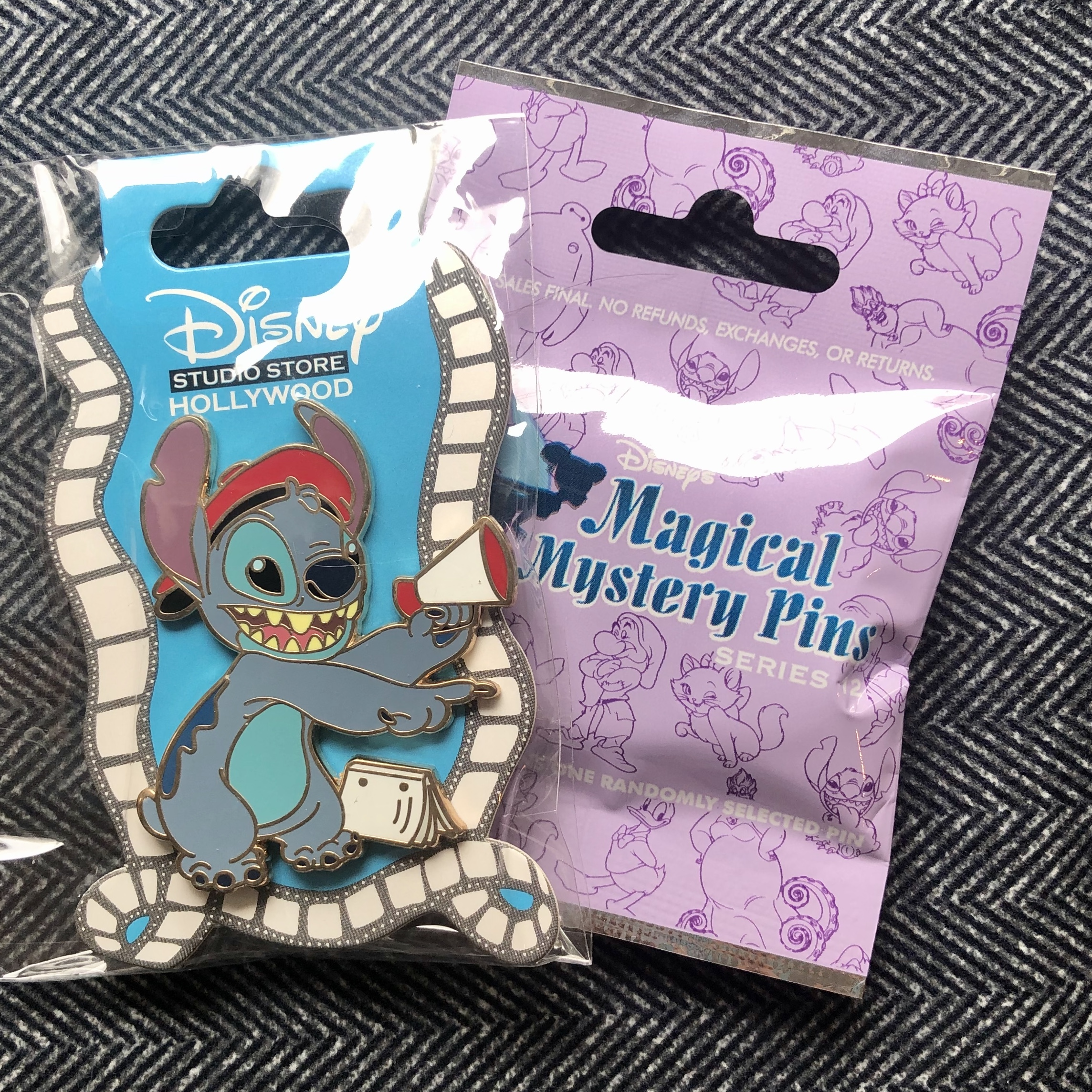 Director Stitch pin and a mystery bag