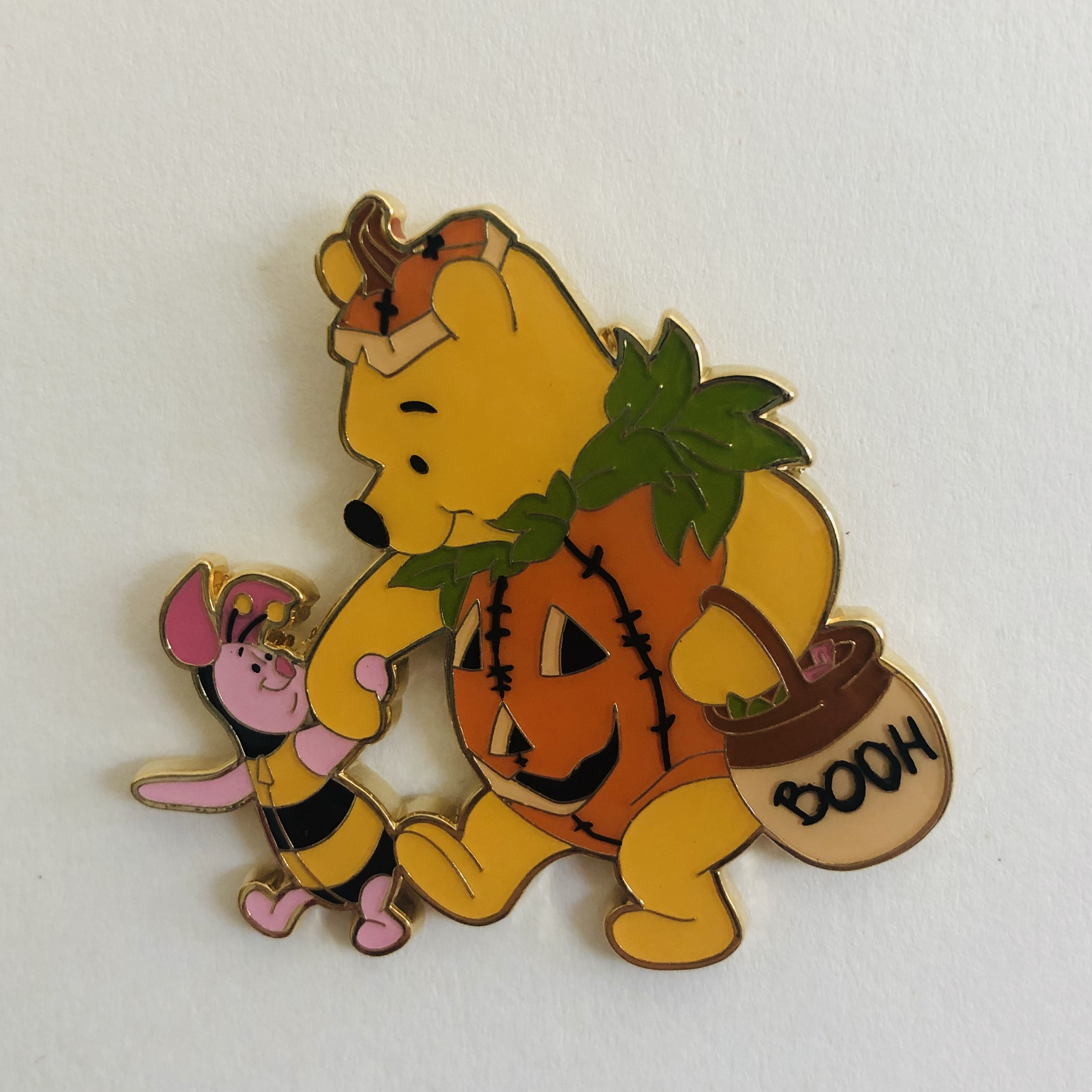 Winnie the Pooh and Piglet, Pooh is dressed as a pumpkin and Piglet as a bumble bee